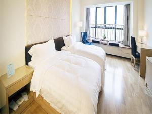 Suzhou Puyu Jundi Bokeli Apartment, Apartmanok  Szucsou - big - 1