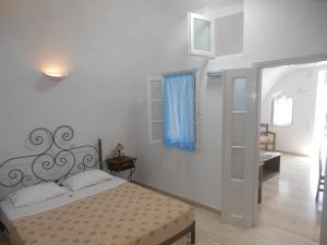 Nomikos Villas, Апарт-отели  Тира - big - 28
