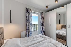 Apartamenty Apartinfo Ocean Waves, Apartments  Gdańsk - big - 5