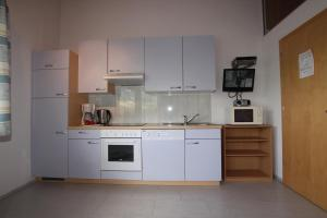 Haus Gugglberger, Апартаменты  Хайнценберг - big - 14