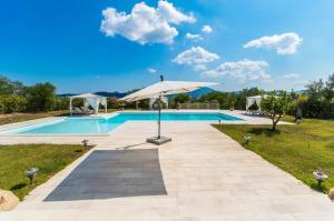 Villa bianca, Ville  Arzachena - big - 14