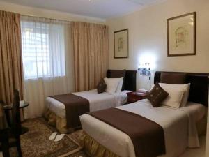 Al Muraqabat Plaza Hotel Apartments - Dubai