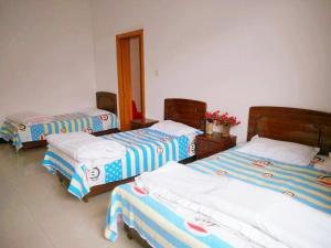 Beidaihe Homeparty Self Catering Villa No.2, Виллы  Циньхуандао - big - 9