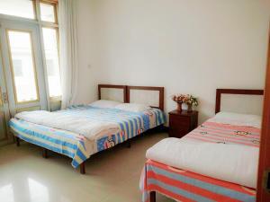 Beidaihe Homeparty Self Catering Villa No.2, Виллы  Циньхуандао - big - 7