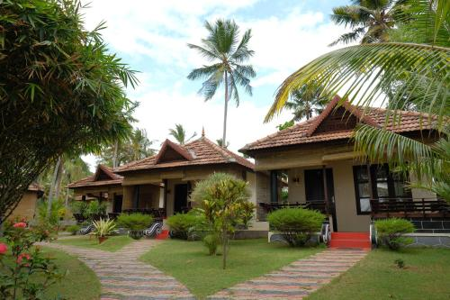 Maadathil Cottages