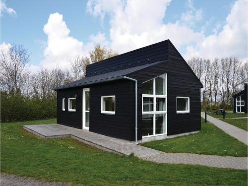 Holiday home Halvejen hytte Spjald