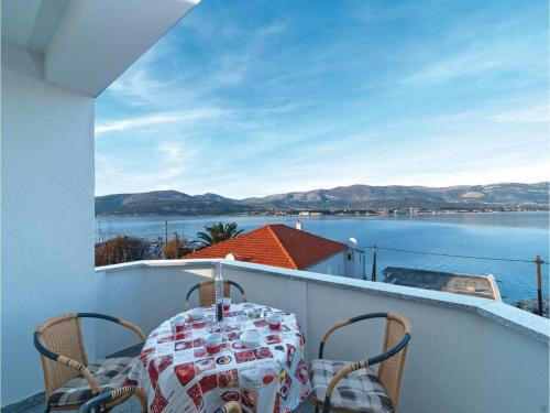 One-Bedroom Apartment Arbanija with Sea View 01