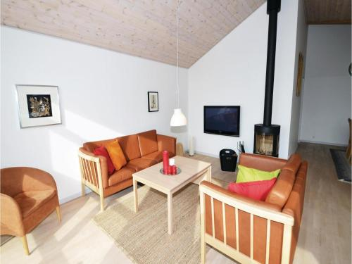 Four-Bedroom Holiday home Knebel with a Fireplace 01