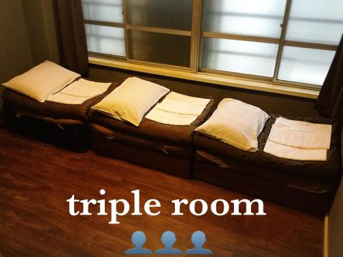 Triple Room (Futon on Wood Flooring)