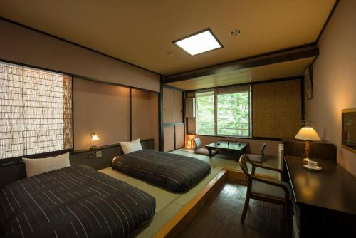 三人房-設榻榻米區 (Triple Room with Tatami Area)