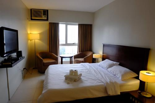 Goldland Millenia Suites by Stays PH, Manila