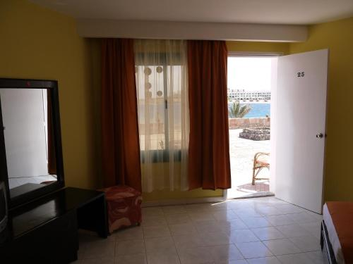 Habitació Triple amb Vistes al Mar Laterals (Triple Room with Side Sea View)
