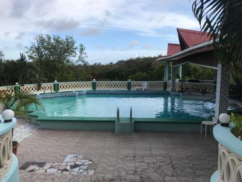 Savannes Garden Inn, Rouarné