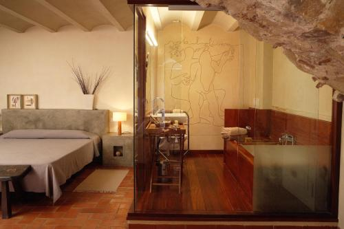 Suite Hotel la Plaça Madremanya 11