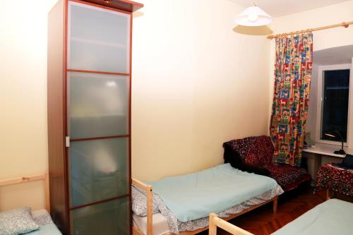 Bed in 3-Bed Female Dormitory Room with Shared Bathroom