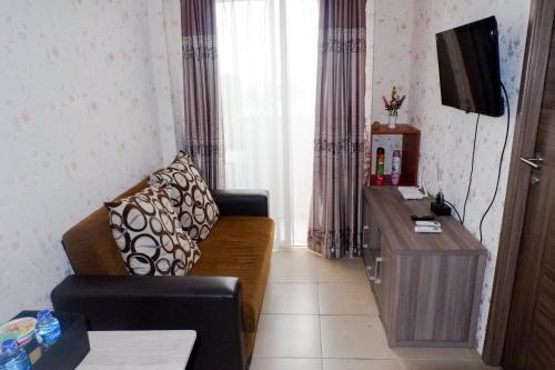 Best Price 2BR Medina Apartment near Karawaci & Gading Serpong By Travelio, Tangerang