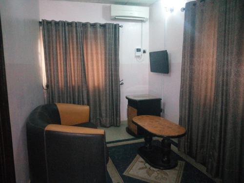 Bayse One Executive Suites and Bar, Adegbite