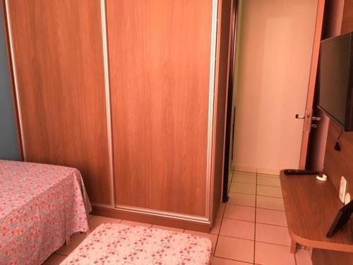 Quarto em apartamento na cidade de Goiânia