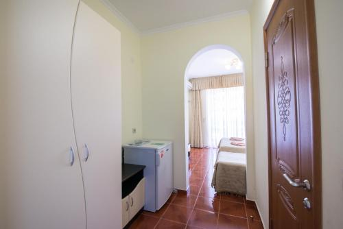 Habitació Quàdruple amb Balcó (Quadruple Room with Balcony)