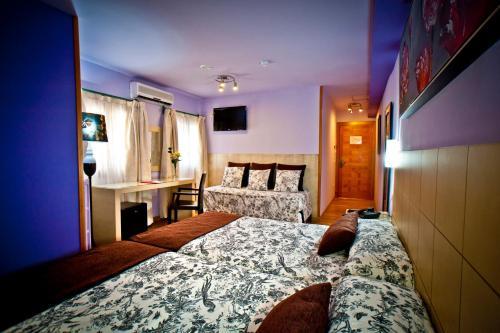 Dreibettzimmer Hotel Condes de Castilla 4
