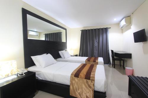 Отель Airport Kuta Hotel and Residences 2 звезды Индонезия