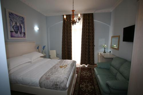 Apartmá typu King s výhledem na bazén (King Suite with Pool View)