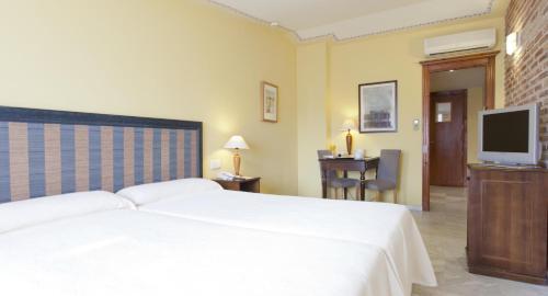 Habitación Doble con cama supletoria - 1 o 2 camas  Ad Hoc Parque Golf 6