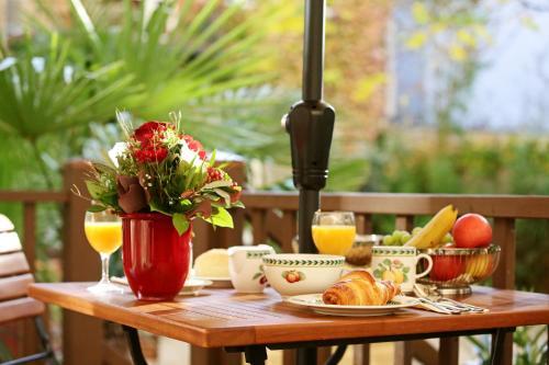 apartahotel garden living boutique hotel berl n desde 137 rumbo. Black Bedroom Furniture Sets. Home Design Ideas