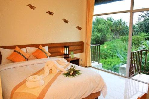 rithima srichumsaeng riverside resort