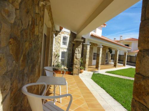 Hotel apartamentos em moradia com jardim cascais rumbo for Hoteles familiares portugal