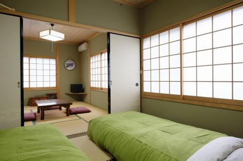 Family Room with Tatami Floor with Shared Bathroom