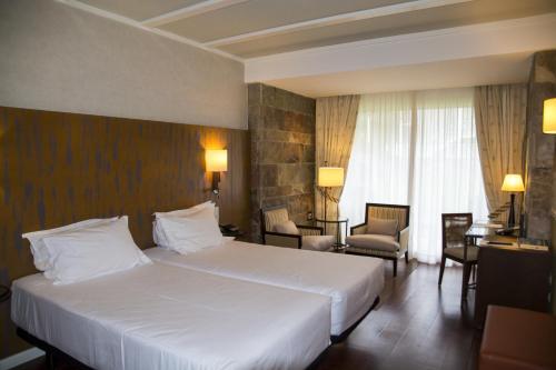 Habitación Doble Estándar - 2 camas Hotel Nuevo Portil Golf 1