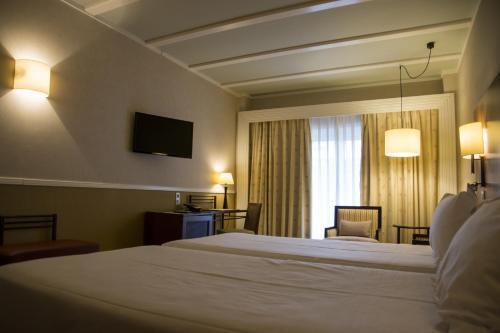 Habitación Doble Estándar - 2 camas  Hotel Nuevo Portil Golf 7