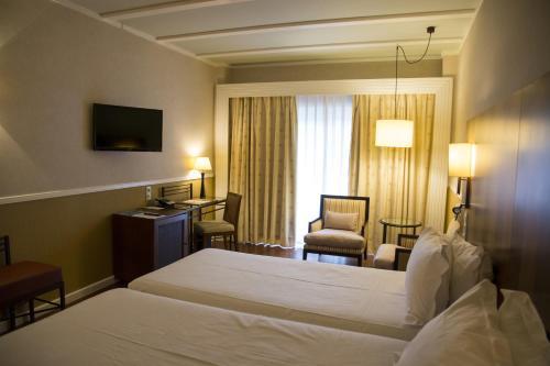 Habitación Doble Estándar - 2 camas Hotel Nuevo Portil Golf 8