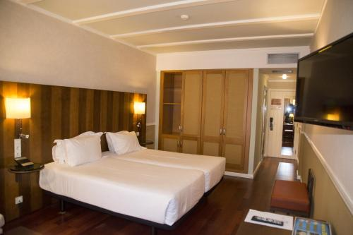Habitación Doble Estándar - 2 camas  Hotel Nuevo Portil Golf 9