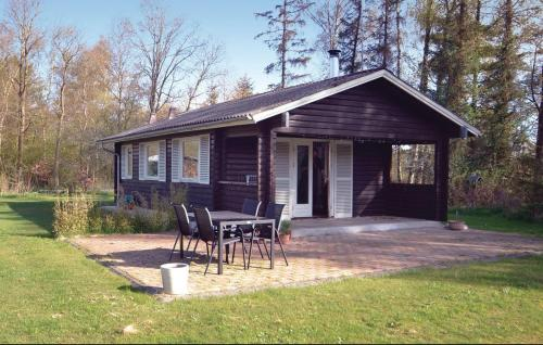 Two-Bedroom Holiday home with a Fireplace in �rsted
