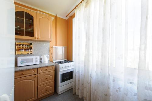 One-Bedroom Apartment with Balcony - Novolesnaya Street 18/2