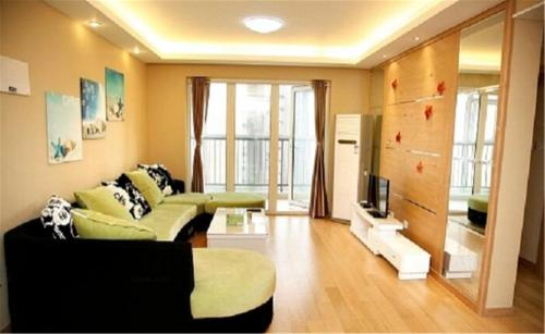 Отель Qingdao Warm-Love Colorful Serviced Apartment 0 звёзд Китай