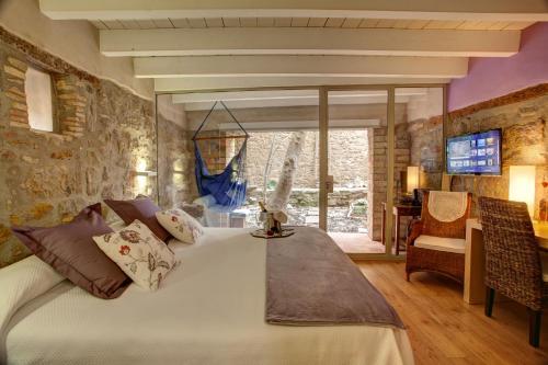Habitación Doble Deluxe con jardín privado Hotel La Freixera 1
