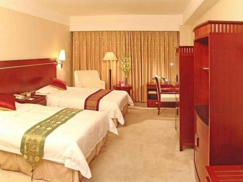 Отель Tianbao International Hotel 4 звезды Китай