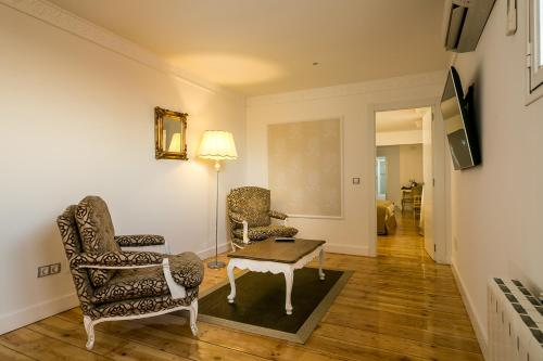 Habitación Doble Deluxe Hostal Central Palace Madrid 3