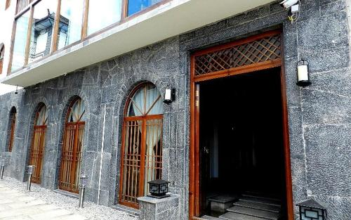 Отель Dali Shuanglang ManTime Boutique Inn 4 звезды Китай