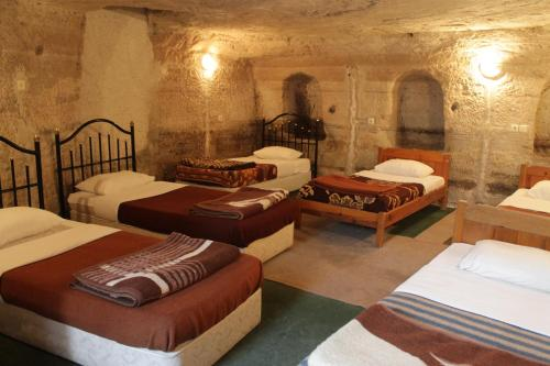 Bed in 6-Bed Cave Dormitory Room with Shared Bathroom and Toilet