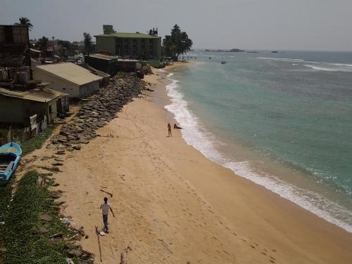 Отель Happy Tuna Beach Hostel 0 звёзд Шри-Ланка
