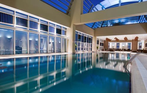 Grand Millennium Al Wahda Hotel Apartment impression