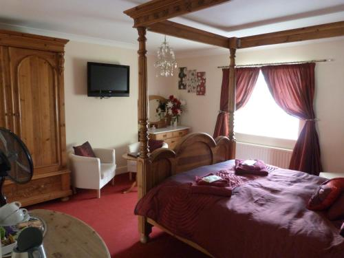 Deluxe King Room with Four Poster Bed