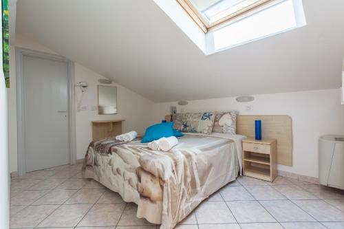 Double or Twin Room Attic with Beach Package