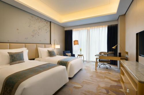 Summer trip with kids Package - Deluxe Room with City View free upgrade to Deluxe Room with Garden V