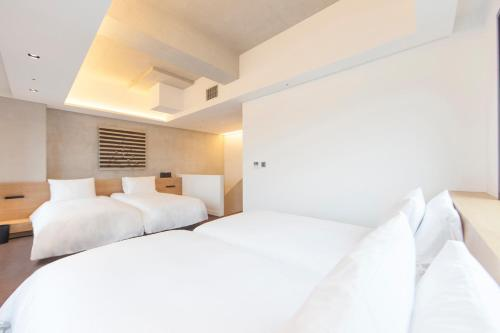 樓中樓四人房 (Duplex Quadruple Room)