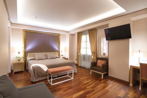 Habitación Deluxe con cama extragrande Casa Consistorial 2